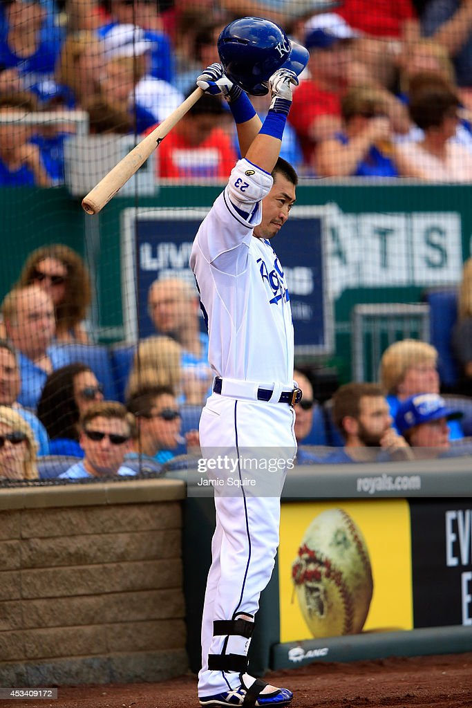 Norichika Aoki #23 of the Kansas City Royals stretches in the on deck circle while waiting to bat during the 4th inning of the game against the San Francisco Giants at Kauffman Stadium on August 9, 2014 in Kansas City, Missouri.