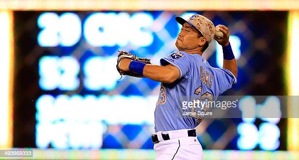 Norichika Aoki of the Kansas City Royals throws toward home after fielding the ball during the 8th inning of the game against the Houston Astros at...