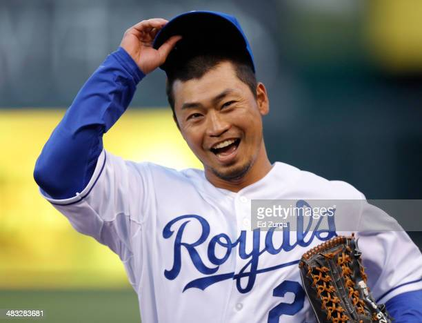 Norichika Aoki of the Kansas City Royals tips his hat to the crowd after catching a ball hit by Ben Zobrist of the Tampa Bay Rays in the first inning...