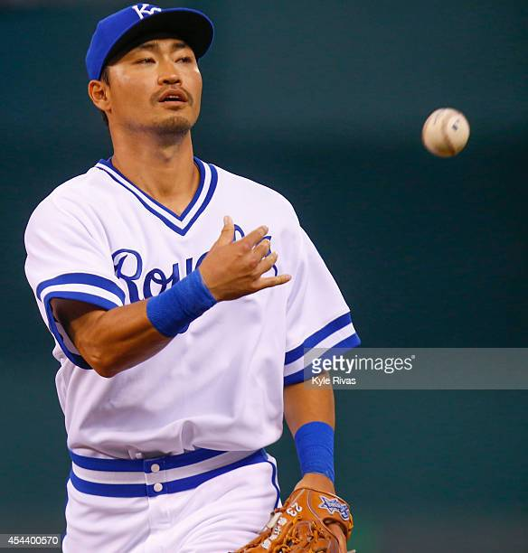 Norichika Aoki of the Kansas City Royals tosses the ball into the fans after making an outfield catch that ended the inning against the Cleveland...