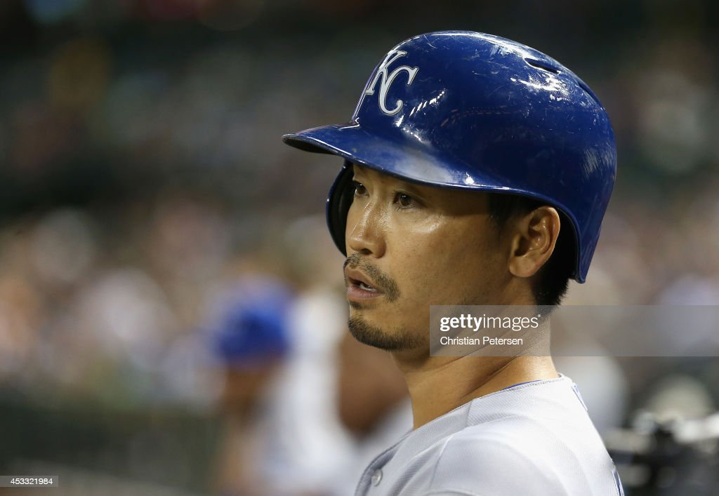 Norichika Aoki #23 of the Kansas City Royals watches from the dugout during the MLB game against the Arizona Diamondbacks at Chase Field on August 7, 2014 in Phoenix, Arizona. The Royals defeated the Diamondbacks 6-2.