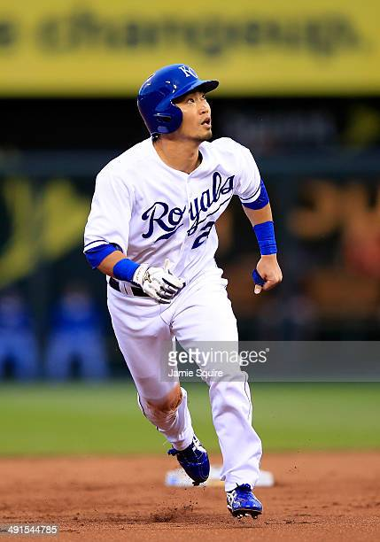 Norichika Aoki of the Kansas City Royals watches the ball as he leaves second base during the 1st inning of the game against the Baltimore Orioles at...