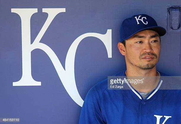 Norichika Aoki of the Kansas City Royals watches the New York Yankees take batting practice from the team dugout prior to a game at Kauffman Stadium...