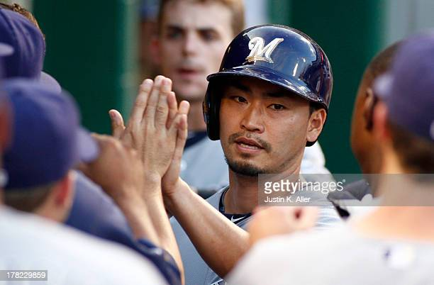 Norichika Aoki of the Milwaukee Brewers celebrates after scoring in the first inning against the Pittsburgh Pirates during the game on August 27 2013...
