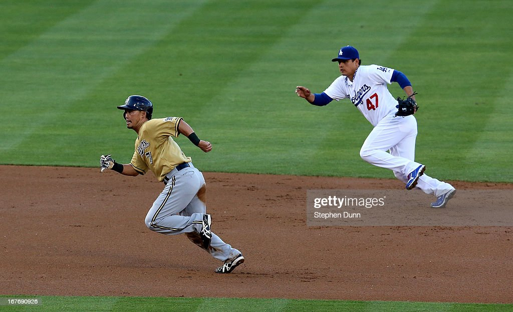Norichika Aoki #7 of the Milwaukee Brewers runs to third base as shortstop Luis Cruz #47 of the Los Angeles Dodgers runs for ground ball in the first inning at Dodger Stadium on April 27, 2013 in Los Angeles, California.