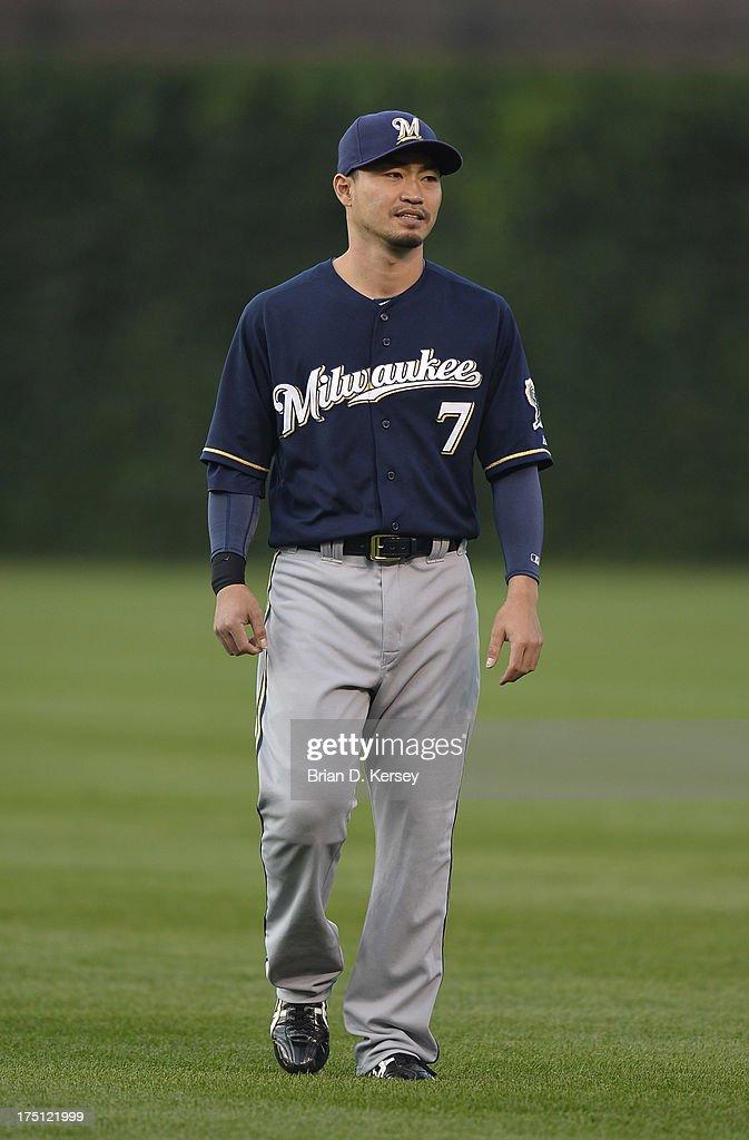 Norichika Aoki #7 of the Milwaukee Brewers warms up before the game against the Chicago Cubs at Wrigley Field on July 31, 2013 in Chicago, Illinois. The Cubs defeated the Brewers 6-1.