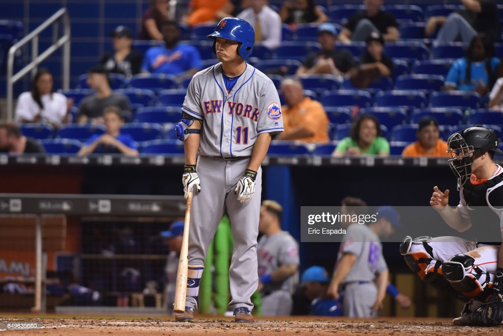 Norichika Aoki #11 of the New York Mets at bat during the ninth inning against the Miami Marlins at Marlins Park on September 19, 2017 in Miami, Florida.
