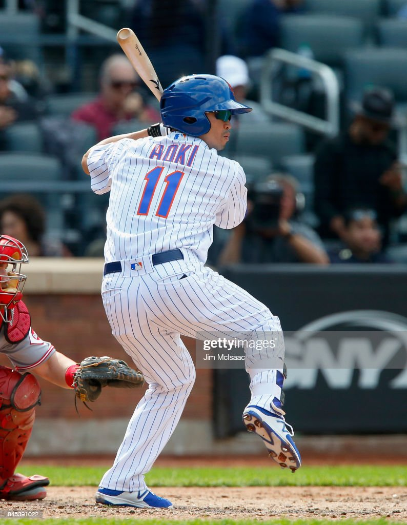 Norichika Aoki #11 of the New York Mets bats in the sixth inning against the Cincinnati Reds at Citi Field on September 10, 2017 in the Flushing neighborhood of the Queens borough of New York City. The Reds defeated the Mets 10-5.