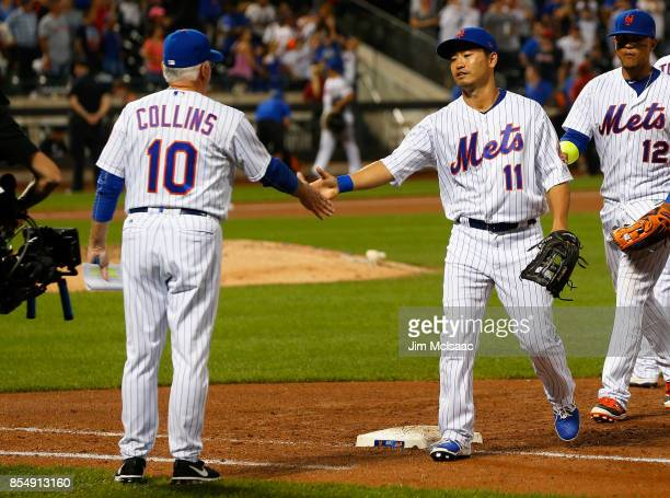 Norichika Aoki of the New York Mets celebrates with manager Terry Collins after defeating the Atlanta Braves at Citi Field on September 27 2017 in...