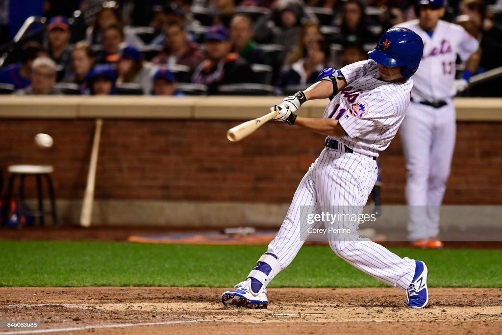Norichika Aoki #11 of the New York Mets connects but ends the inning with a forced out of a runner at second base during the fifth inning against the Cincinnati Reds at Citi Field on September 9, 2017 in the Flushing neighborhood of the Queens borough of New York City. The Mets won 6-1.