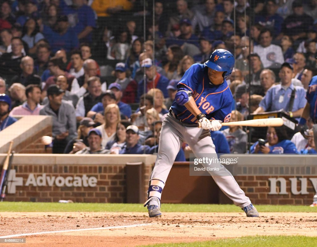 Norichika Aoki #11 of the New York Mets hits a single against the Chicago Cubs during the third inning on September 13, 2017 at Wrigley Field in Chicago, Illinois.