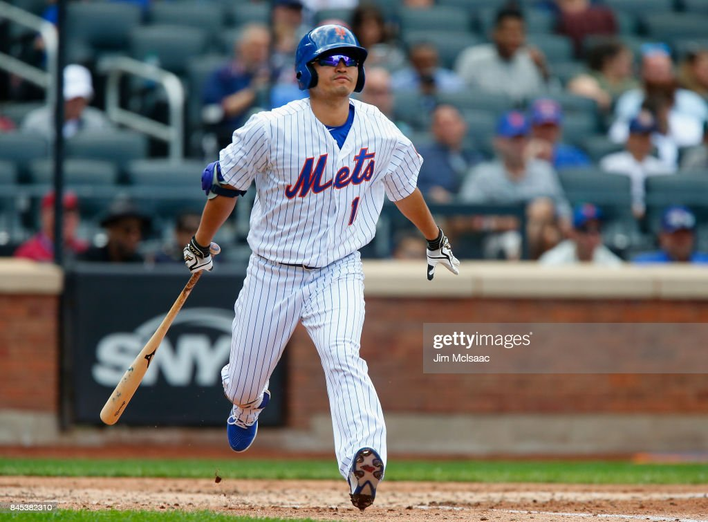 Norichika Aoki #11 of the New York Mets lines out in the fifth inning against the Cincinnati Reds at Citi Field on September 10, 2017 in the Flushing neighborhood of the Queens borough of New York City.
