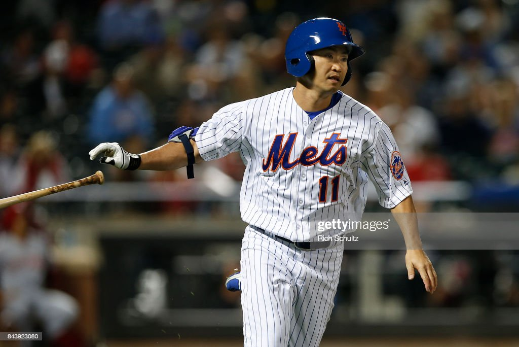 Norichika Aoki #11 of the New York Mets pops up to shortstop against the Cincinnati Reds during the sixth inning of a game at Citi Field on September 7, 2017 in the Flushing neighborhood of the Queens borough of New York City. The Mets defeated the Reds 7-2.