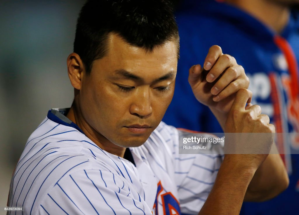 Norichika Aoki #11 of the New York Mets practices his swing in the dugout during a game against the Cincinnati Reds at Citi Field on September 7, 2017 in the Flushing neighborhood of the Queens borough of New York City. The Mets defeated the Reds 7-2.