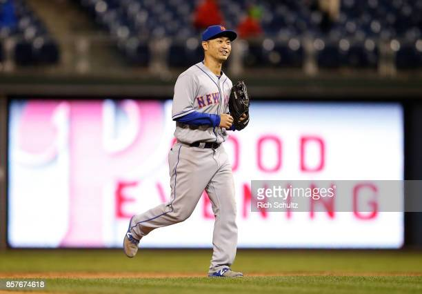 Norichika Aoki of the New York Mets runs off the field after defeating the Philadelphia Phillies 74 in 11 innings during a game at Citizens Bank Park...