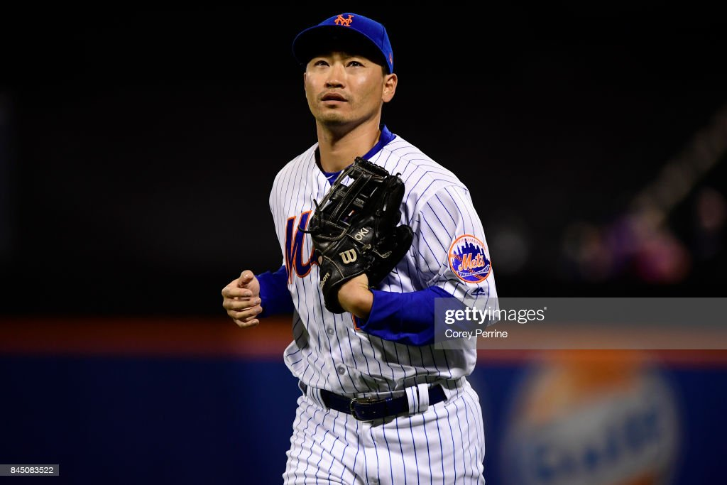 Norichika Aoki #11 of the New York Mets runs to the dugout during the eighth inning against the Cincinnati Reds at Citi Field on September 9, 2017 in the Flushing neighborhood of the Queens borough of New York City. The Mets won 6-1.