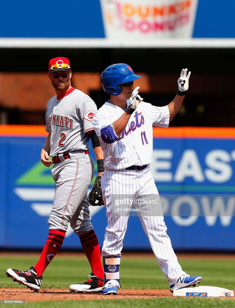 Norichika Aoki #11 of the New York Mets stands at second base after his first-inning double as Zack Cozart #2 of the Cincinnati Reds looks on at Citi Field on September 10, 2017 in the Flushing neighborhood of the Queens borough of New York City.