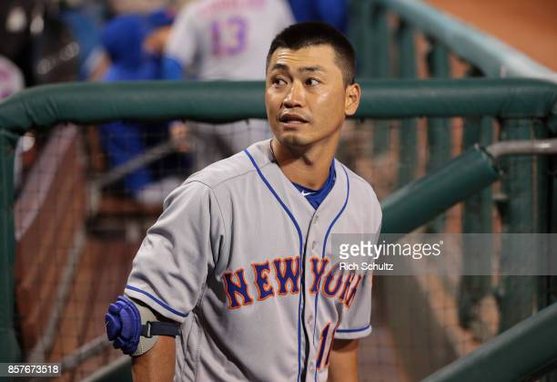 Norichika Aoki of the New York Mets stands in the dugout before his first at bat against the Philadelphia Phillies during the first inning of a game...