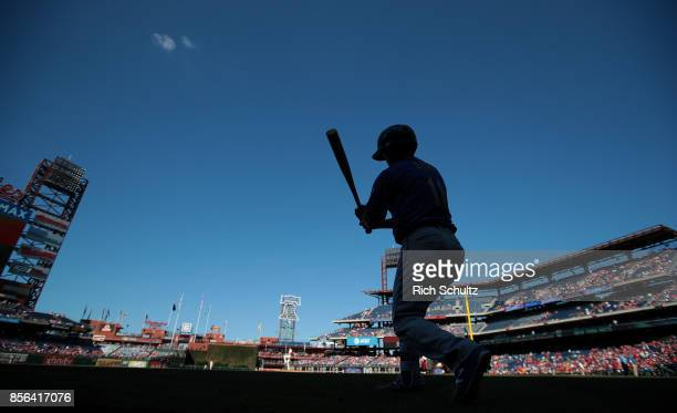 Norichika Aoki of the New York Mets takes his cuts in the on deck circle before his first at bat against the Philadelphia Phillies during the first...