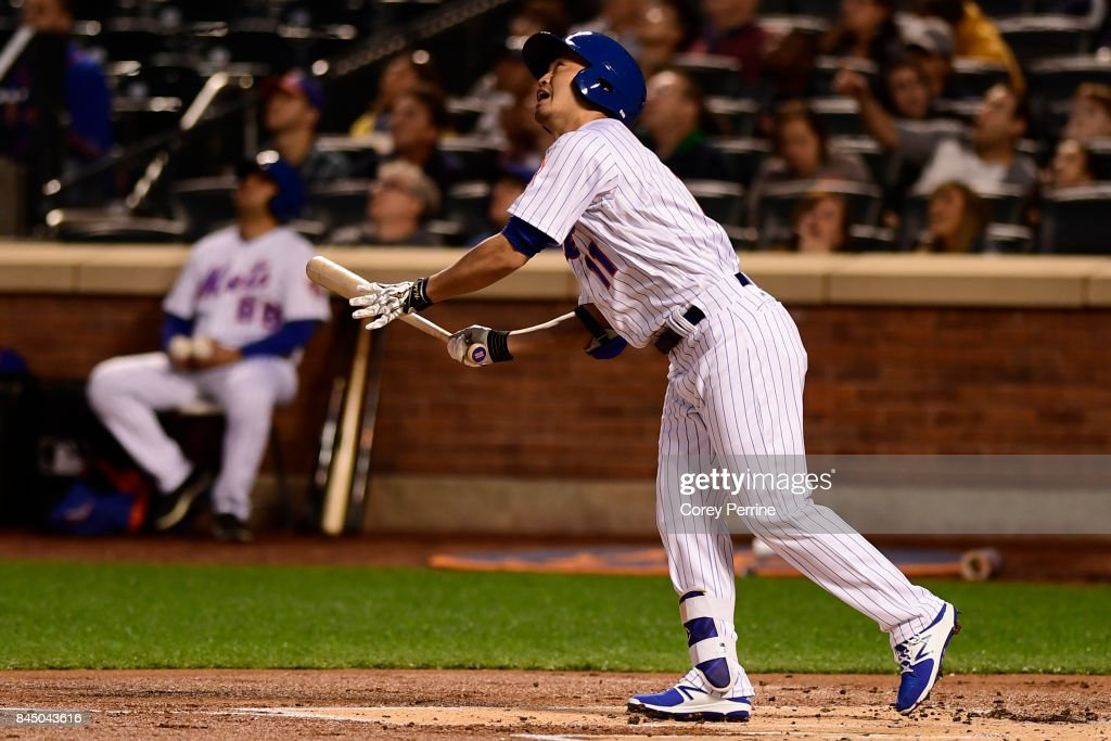 Norichika Aoki #11 of the New York Mets watches as he flies out against the Cincinnati Reds during the first inning at Citi Field on September 9, 2017 in the Flushing neighborhood of the Queens borough of New York City.