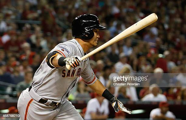 Norichika Aoki of the San Francisco Giants hits a single against the Arizona Diamondbacks during the third inning of the Opening Day MLB game at...