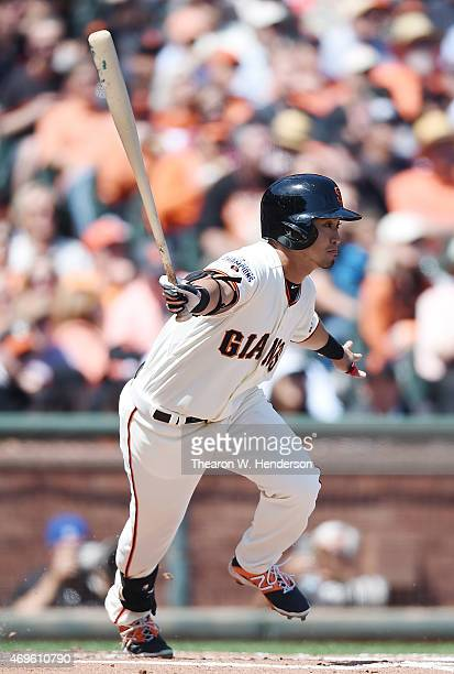 Norichika Aoki of the San Francisco Giants hits a single against the Colorado Rockies in the bottom of the first inning on Opening Day at ATT Park on...