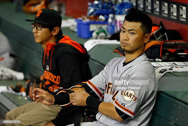 Norichika Aoki of the San Francisco Giants watches from the dugout during the fifth inning of the MLB game against the Arizona Diamondbacks at Chase...