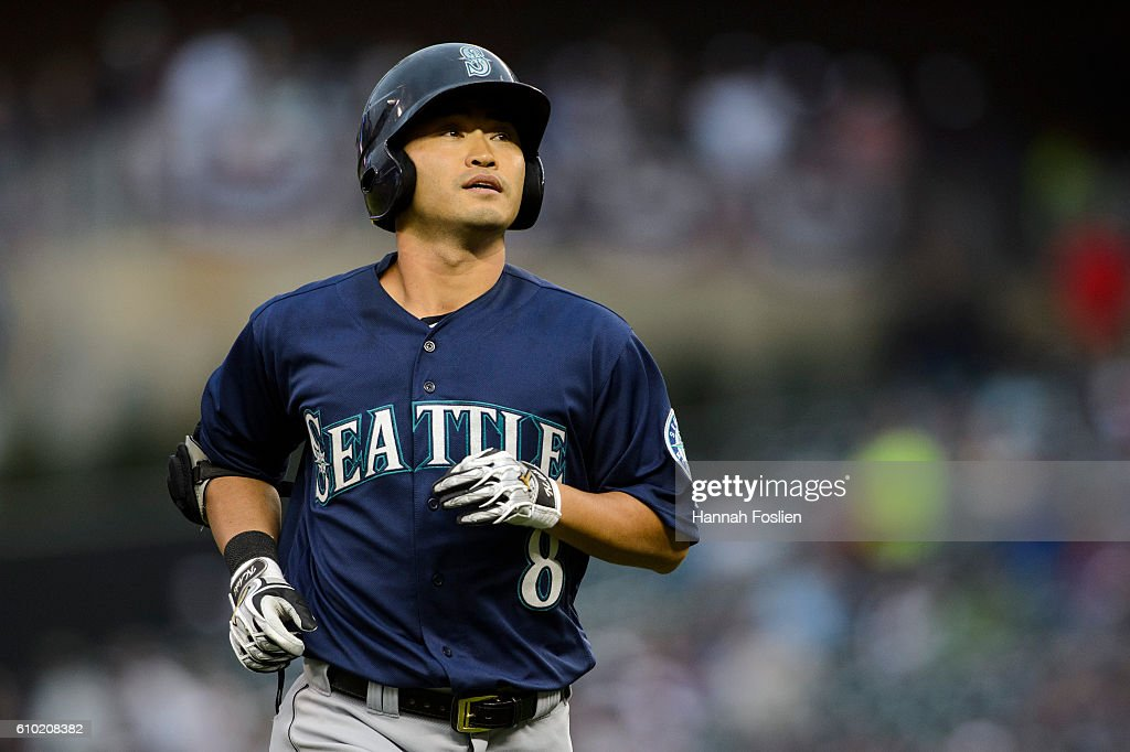 Norichika Aoki #8 of the Seattle Mariners returns to the dugout after flying out to right field in an at bat against the Minnesota Twins during the first inning of the game on September 24, 2016 at Target Field in Minneapolis, Minnesota. The Twins defeated the Mariners 3-2.