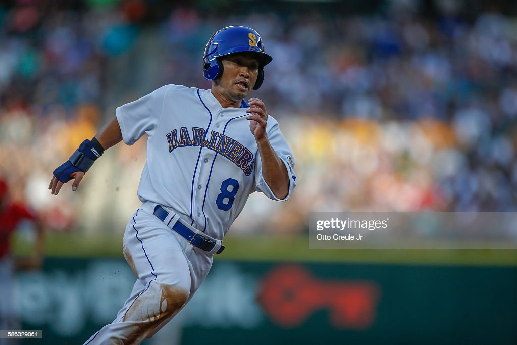 Norichika Aoki #8 of the Seattle Mariners rounds the bases on his way to score on an RBI single off the bat of Robinson Cano in the first inning against the Los Angeles Angels of Anaheim at Safeco Field on August 5, 2016 in Seattle, Washington.