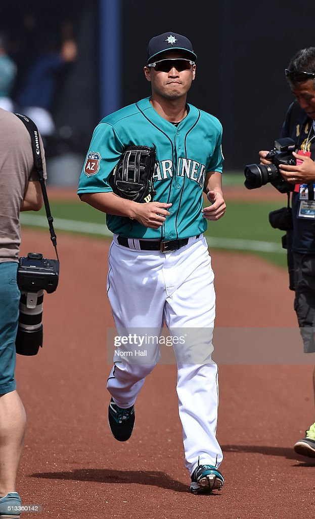 Norichika Aoki #8 of the Seattle Mariners runs to his dugout prior to the start of a game against the San Diego Padres at Peoria Stadium on March 2, 2016 in Peoria, Arizona. Seattle won 7-0.