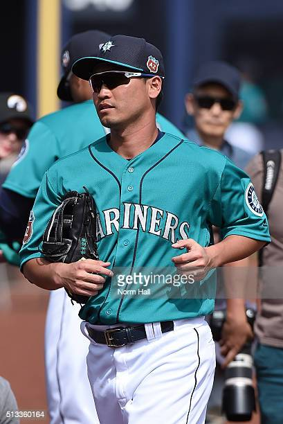 Norichika Aoki of the Seattle Mariners runs to his dugout prior to the start of a game against the San Diego Padres at Peoria Stadium on March 2 2016...