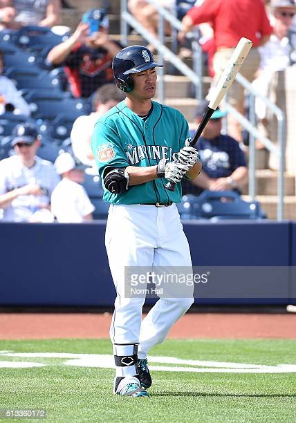Norichika Aoki of the Seattle Mariners walks up to home plate during the first inning against the San Diego Padres at Peoria Stadium on March 2 2016...