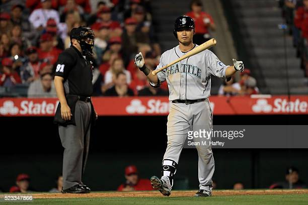 Norichika Aoki of the the Seattle Mariners throws his bat after striking out during theseventh inning of a baseball game between the Los Angeles...