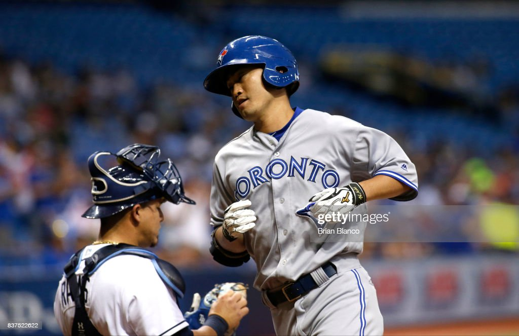 Norichika Aoki #23 of the Toronto Blue Jays crosses home plate in front of catcher Wilson Ramos #40 of the Tampa Bay Rays after hitting a home run off of pitcher Chris Archer of the Tampa Bay Rays during the first inning of a game on August 22, 2017 at Tropicana Field in St. Petersburg, Florida.