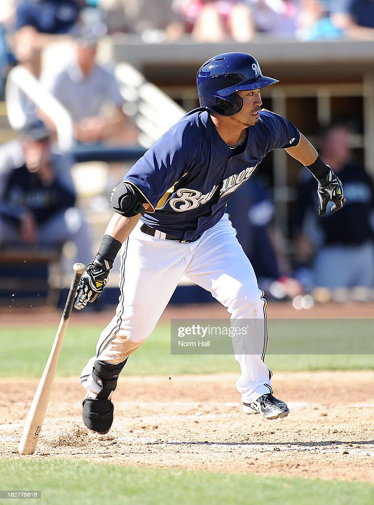 Norichka Aoki #7 of the Milwaukee Brewers runs out of the batters box against the Seattle Mariners at Maryvale Baseball Park on February 26, 2013 in Maryvale, Arizona.