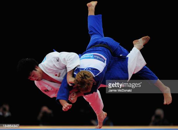 Norihide Yamamoto of Japan throws Yannick Gutsche of Germany during there 90kg Bronze Medal bout during the LOCOG Judo test event for London 2012 at...