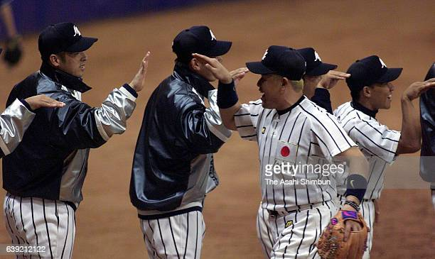 Norihiro Nakamura and Japan players celebrate their win after the Baseball preliminary round match between Australia and Japan during the Sydney...