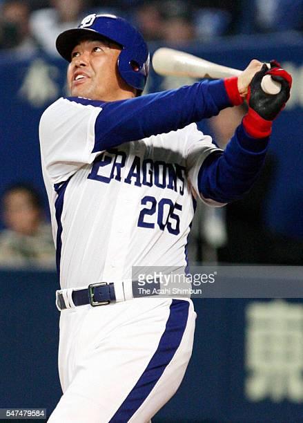 Norihiro Nakamura of Chunichi Dragons hits a homerun in the seventh inning of the game between Chunichi Dragons and Seibu Lions at Nagoya Dome on...