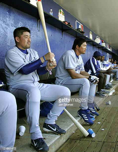 Norihiro Nakamura of Japan playing in his first game as a member of the Los Angeles Dodgers sits with teammate HeeSeop Choi of Korea during game...
