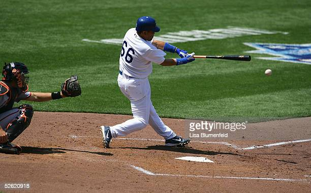 Norihiro Nakamura of the Los Angeles Dodgers doubled to left in the first inning against the San Francisco Giants during the game at Dodger Stadium...