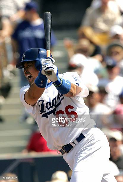 Norihiro Nakamura of the Los Angeles Dodgers swings at a pitch against the San Francisco Giants during the game at Dodger Stadium on April 12 2005 in...
