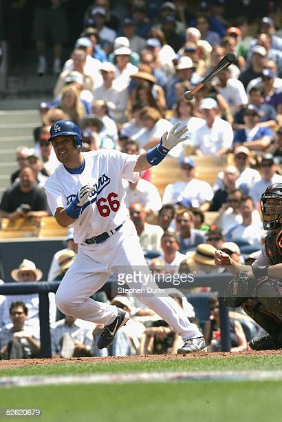 Norihiro Nakamura of the Los Angeles Dodgers throws the bat in the first inning after he doubled to left against of the San Francisco Giants during...