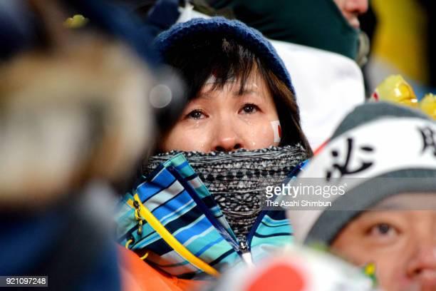 Noriko Hamaya elder sister of Noriaki Kasai of Japan sheds tears after Kasai's second jump during the Ski Jumping Men's Team Large Hill on day ten of...