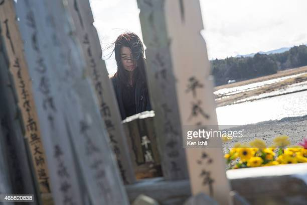 Noriko Iwasaki who lost her uncle by tsunami prays on March 11 2015 in Ukedo Fukushima prefecture Japan On March 11 Japan commemorates the fourth...