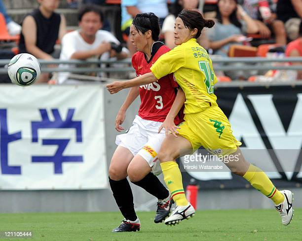 Noriko Kawamura of JEF United Ichihara Chiba Ladies and Kyoko Yano of Urawa Red Diamonds Ladies compete for the ball during the Japan Women's...