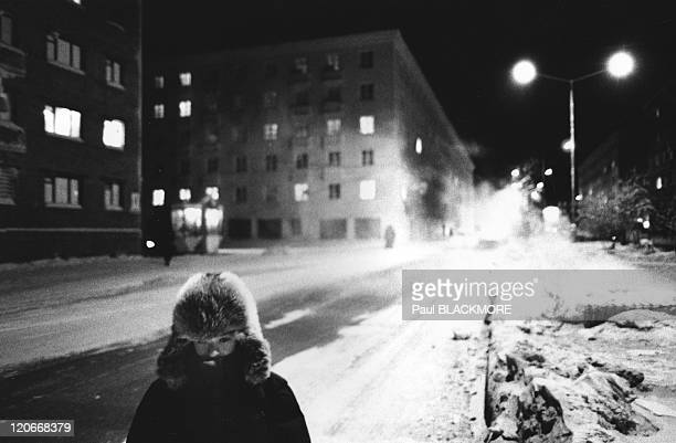 Norilsk Russia A schoolboy walks home at 3 pm during the polar nights