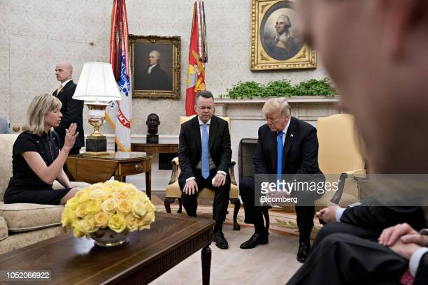 Norine Brunson wife of US Pastor Andrew Brunson left prays for US President Donald Trump right during a meeting with Andrew Brunson center in the...