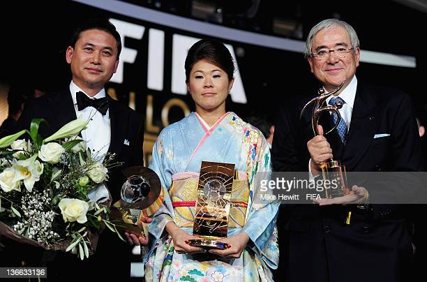 Norio Sasaki Homare Sawa and Junji Ogura with their respective awards during FIFA Ballon d'Or Gala 2011 at the Kongresshaus on January 09 2012 in...