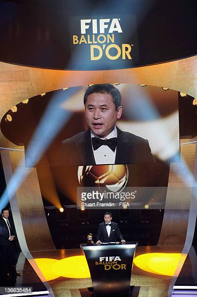 Norio Sasaki of Japan receives his trophy after winning the FIFA World Coach of the Year for Women's Football award at the FIFA Ballon d'Or Gala 2011...