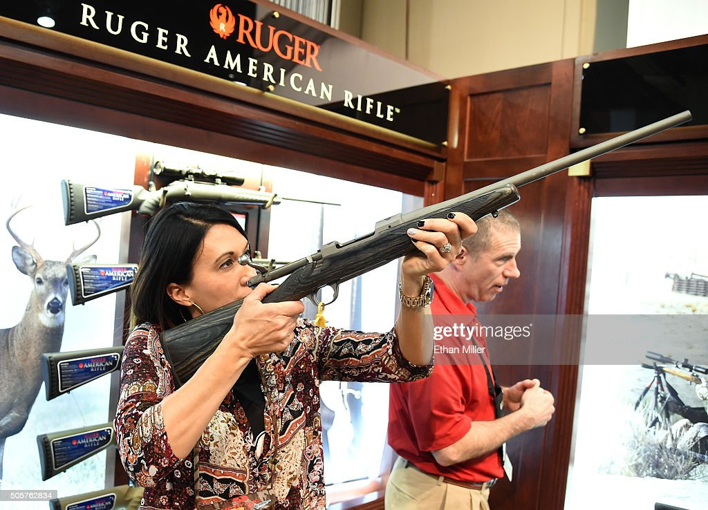Norissa Harman from Girls with Guns Clothing looks at a rifle at the Ruger booth at the 2016 National Shooting Sports Foundation's Shooting, Hunting, Outdoor Trade (SHOT) Show at the Sands Expo and Convention Center on January 19, 2016 in Las Vegas, Nevada. The SHOT Show, the world's largest annual trade show for shooting, hunting and law enforcement professionals, runs through January 23 and is expected to feature 1,600 exhibitors showing off their latest products and services to more than 62,000 attendees.